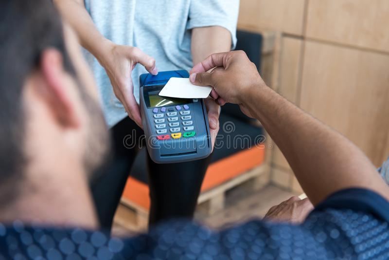 Selective focus of payment by credit card and terminal. In cafe stock image