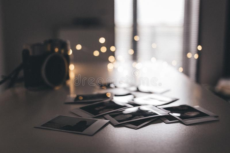 Selective Focus Photo Of Polaroid Films On Table royalty free stock photo