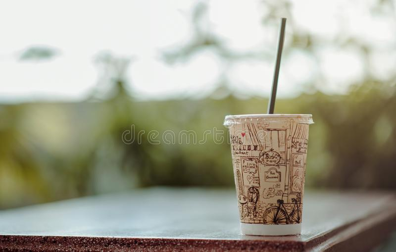 Selective Focus Photo of White Plastic Cup With Lid and Straw royalty free stock photo