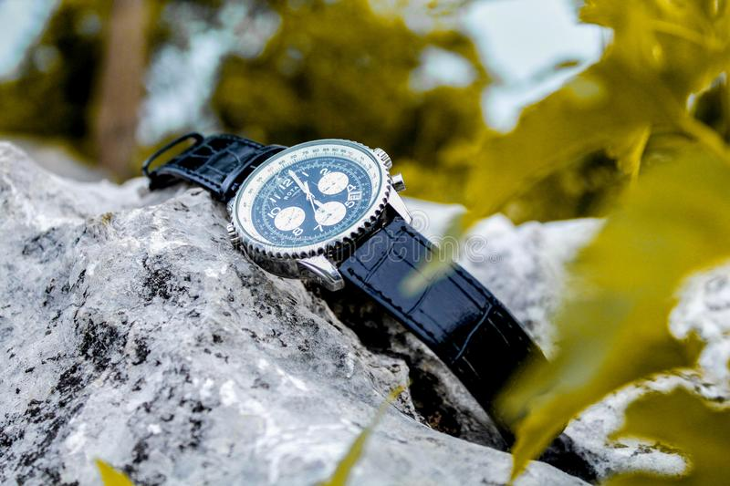 Selective Focus Photography of Chronograph Watch on Rock royalty free stock image