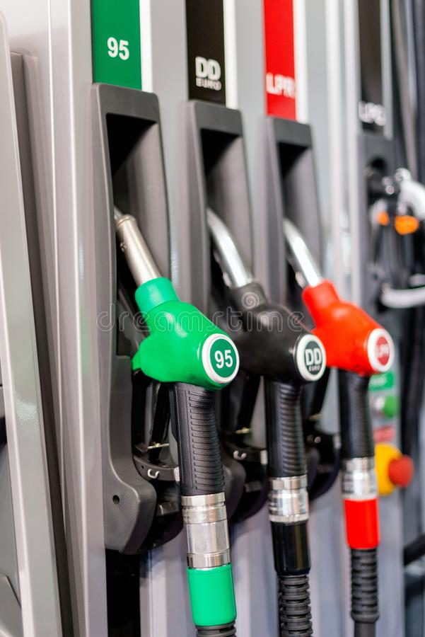 Colorful Petrol pump filling nozzles , Gas station in a service royalty free stock photography