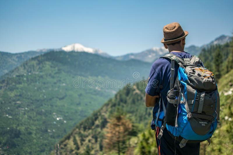Selective Focus Photography of Man Carrying Hiking Pack royalty free stock photography