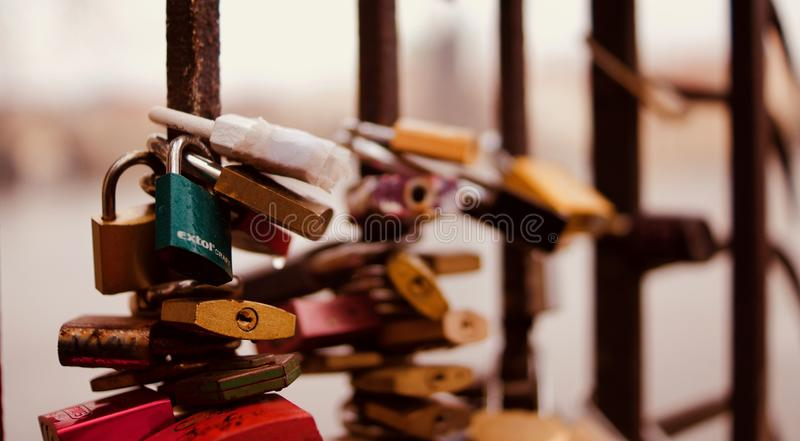 Selective Focus Photography of Padlocks on Fence royalty free stock photography