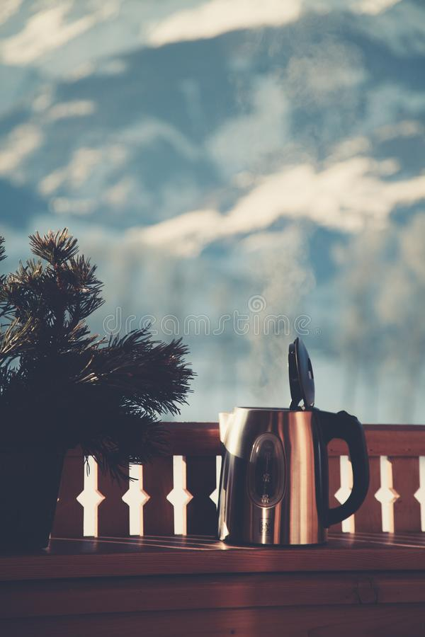 Selective Focus Photography of Silver Electric Kettle Beside Gray Balustrade stock photo