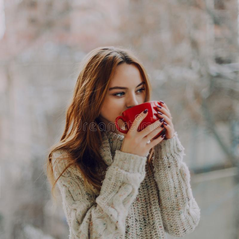Selective Focus Photography of Woman Holding Red Ceramic Cup royalty free stock photography