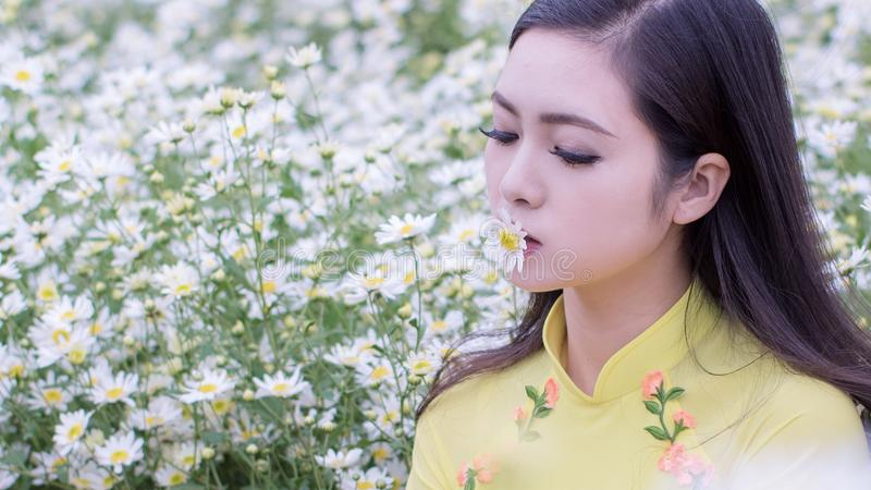 Selective Focus Photography of Woman Kissing White Petaled Flower stock photos