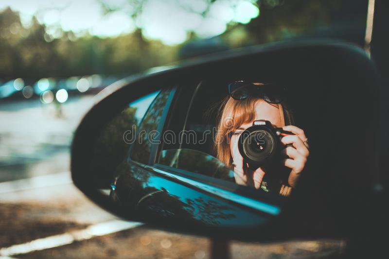 Selective Focus Photography of Woman Taking Camera Through Mirror stock images