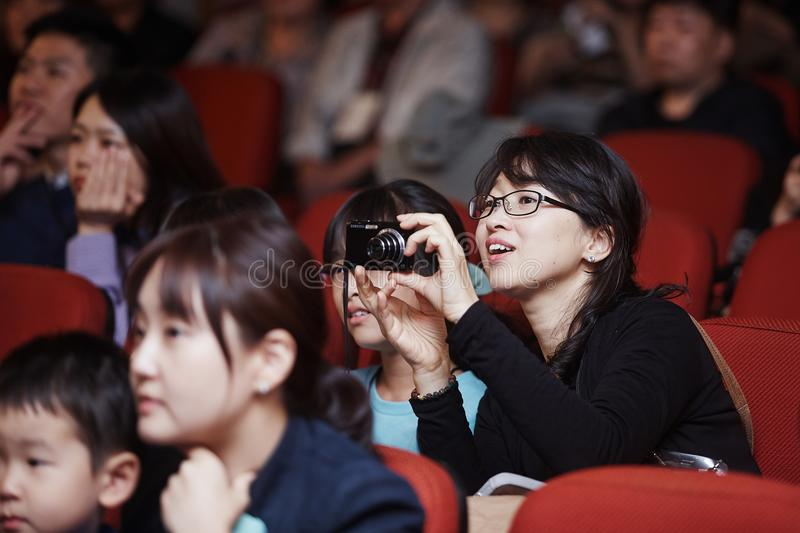 Selective Focus Photography of Woman Wearing Black Jacket Holding Camera stock images