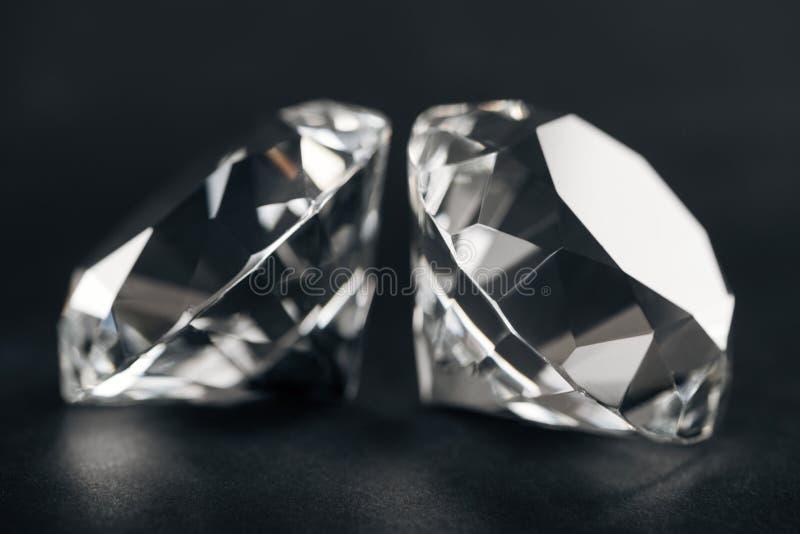 Selective focus of pure diamonds. On black background stock image