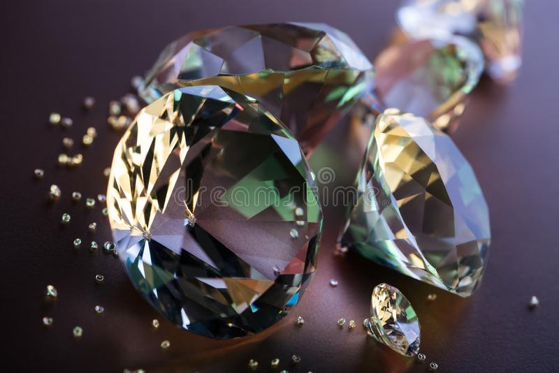 Selective focus of pure diamonds. On brown background royalty free stock photo