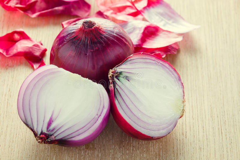 Selective focus purple onion on wood background. Selective focus the purple onion on wood background stock images