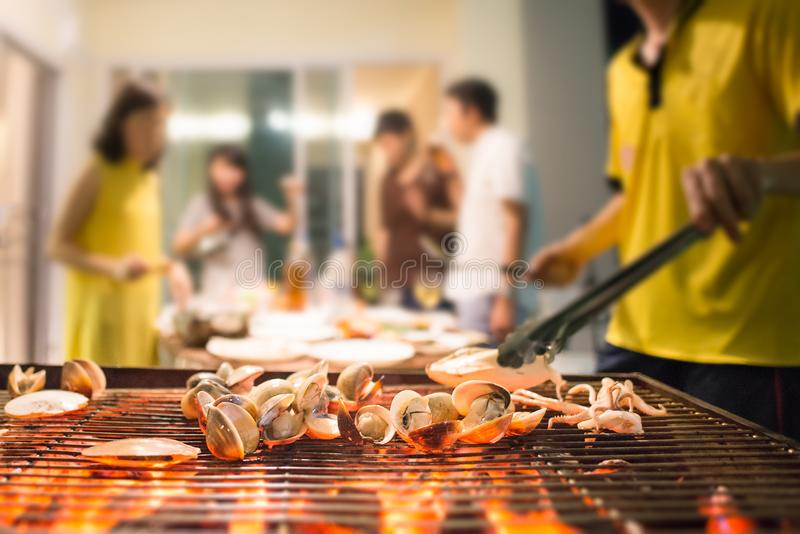 Selective focus on roasted seafood party with blurred background stock image