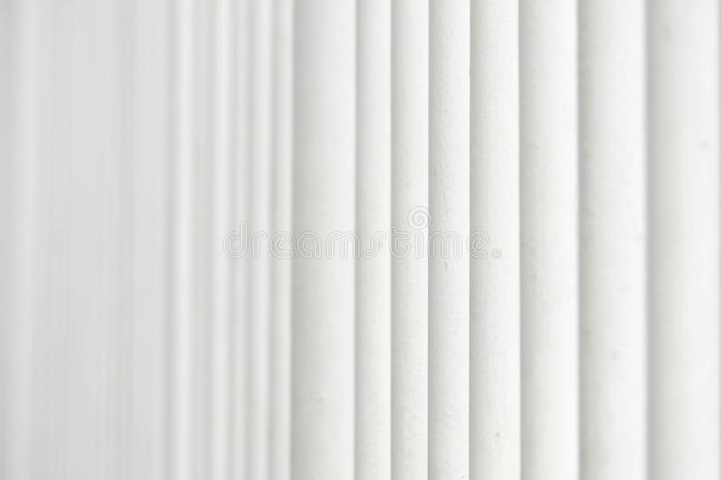 In selective focus a row of white metal fence for background backdrop. Selective focus row white metal fence background backdrop art block cement border concrete royalty free stock image