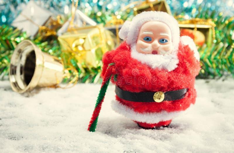 Selective focus santa doll on snowflake and blur Christmas decor. Ation background royalty free stock photo