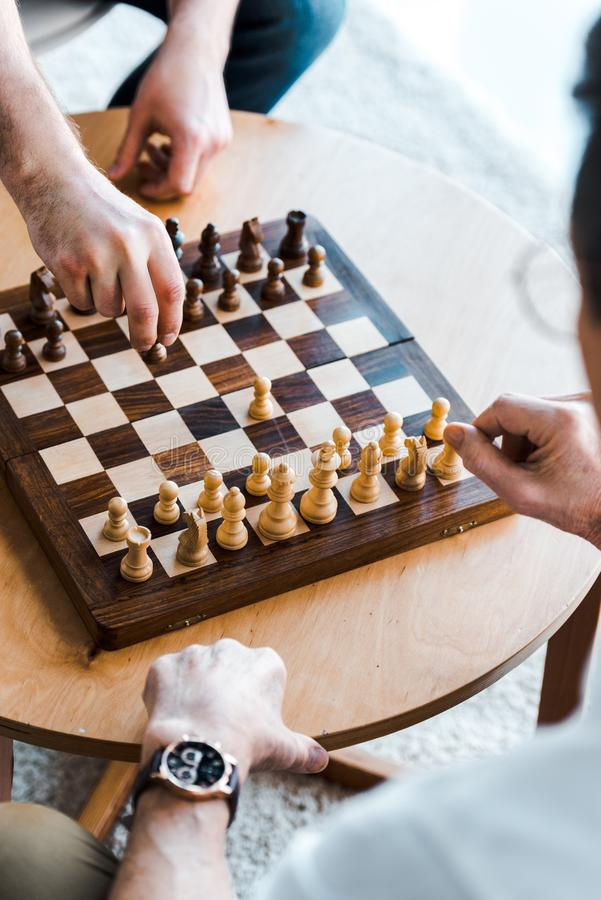Selective focus of seniors playing chess stock photo