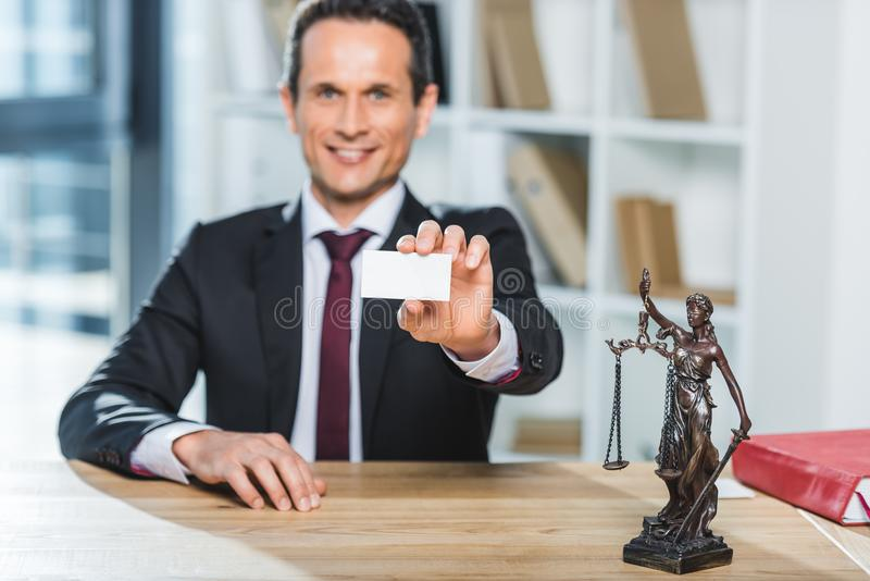 Lawyer with visit card stock photo