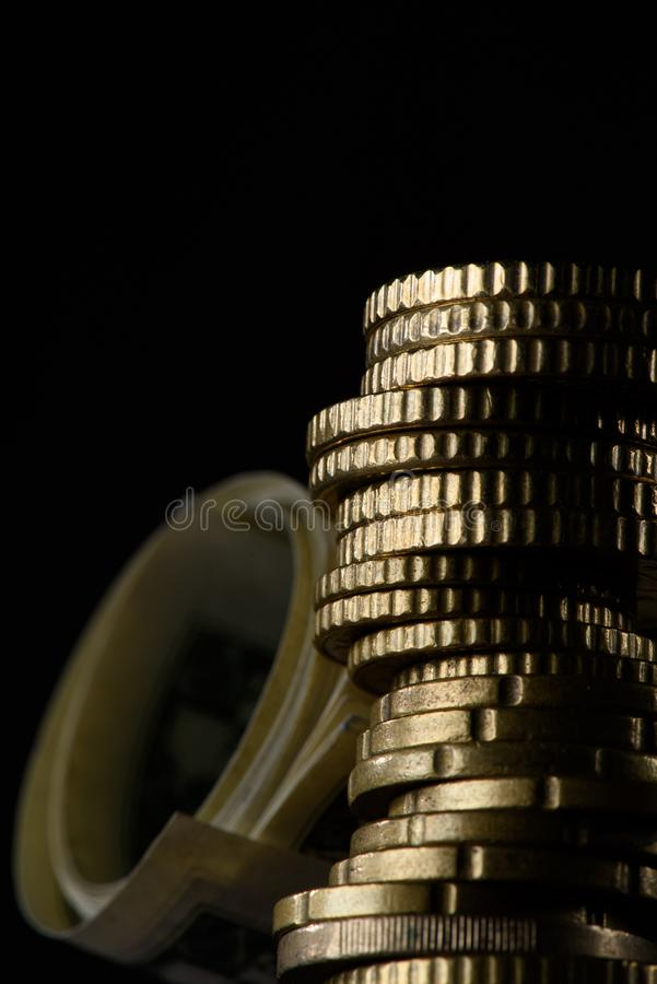 selective focus of stack of coins and rolled banknotes royalty free stock image