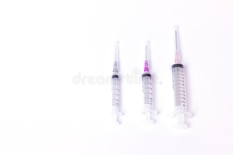Syringe with white background,Injection needle select focus,Medical instruments. Selective focus syringe with white background,Injection needle select focus stock photo
