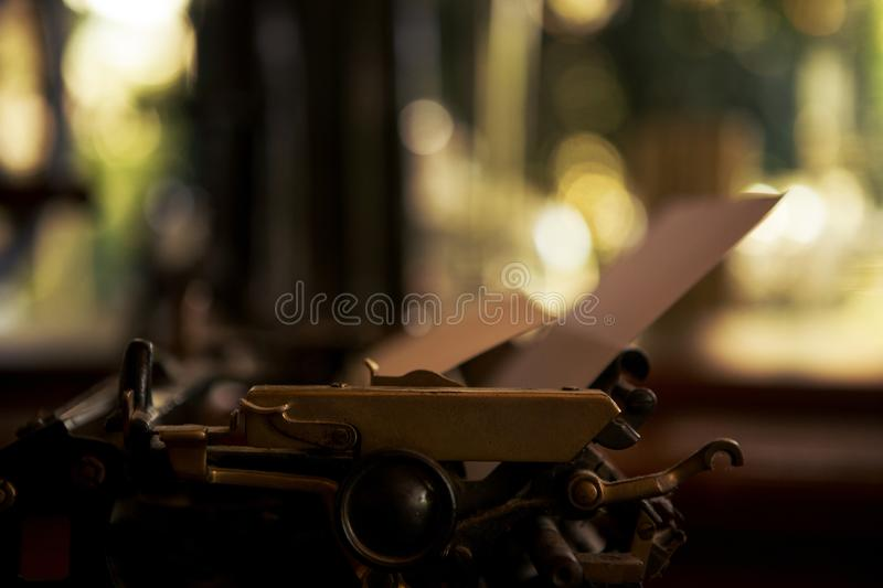 Selective focus on 19th century old black typewriter with blank paper ready for new text. Copy space royalty free stock images