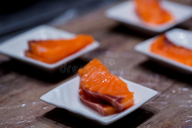 Selective focus to Salmon Sashimi fillet in a small dish royalty free stock photo