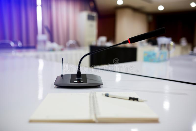 Selective focus to wireless conference microphones stock image