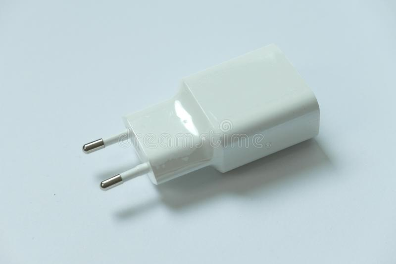 Selective focus of two pin usb mobile phone charger on white background. royalty free stock photos