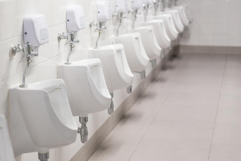 Selective focus of Urinals in bathroom. Selective focus of Urinals in the bathroom stock photos