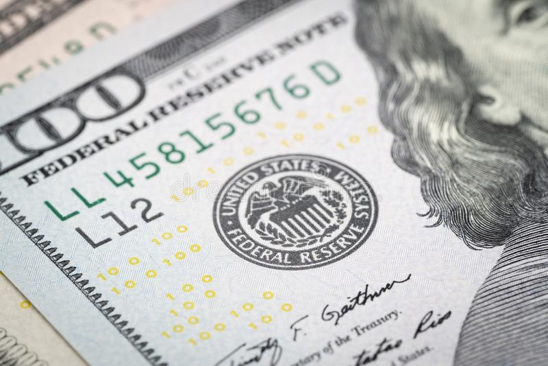 Selective focus on US Federal Reserve emblem on hundred dollars stock images