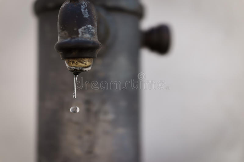 selective focus Vintage water faucet with droplet, as water saving concept. royalty free stock photos