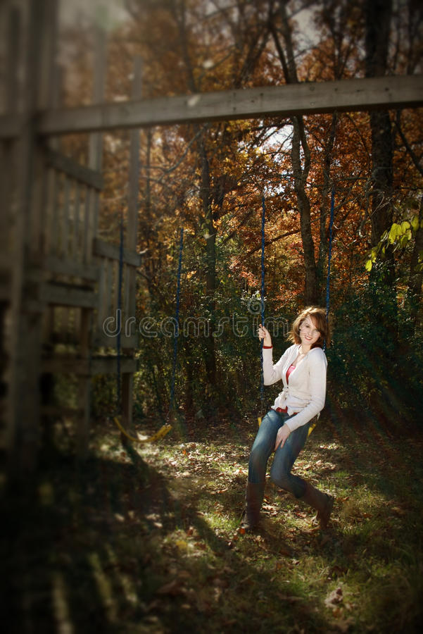 Download Selective Focus Of Woman On Swing, Autumn Royalty Free Stock Photography - Image: 21965557
