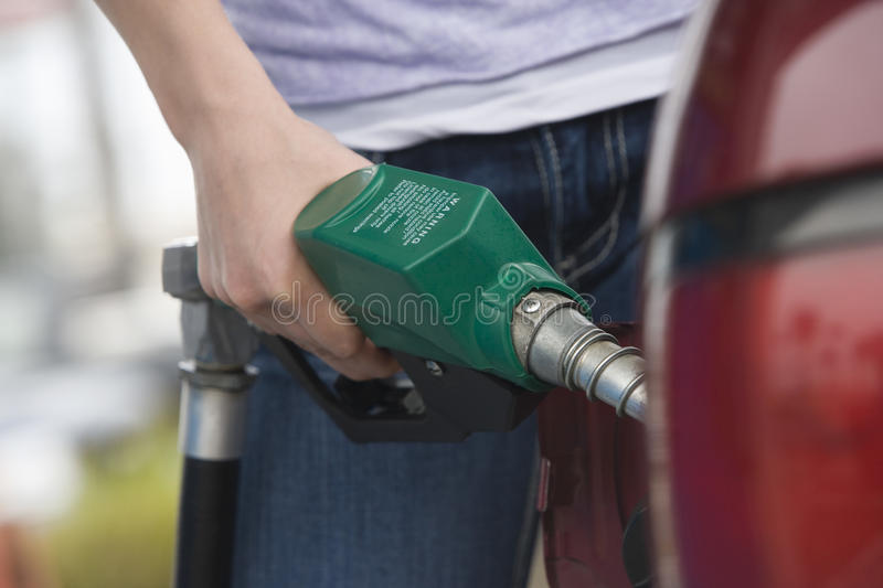 Selective Focus Of A Young Man Refueling His Car Royalty Free Stock Image