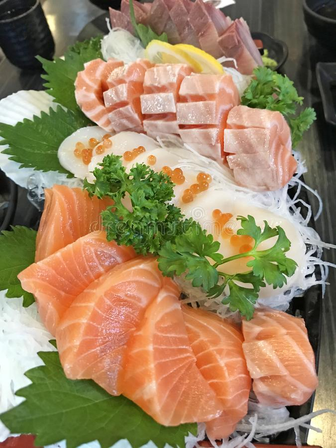 Selective focused on Japanese food cuisine gourmet: platter of sashimi fresh raw fish meat including salmon, fatty salmon, scall stock photo