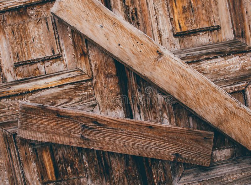 Selective Photo of Two Brown Wood Lumbers barring a door stock photo
