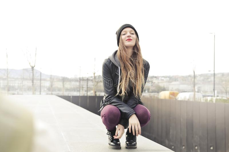 Selective Photo of Woman in Gray Hooded Jacket Doing Crouch Position royalty free stock images