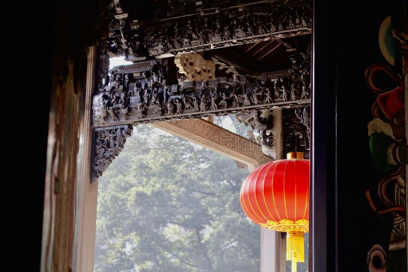 Selective shot of a red paper lantern in a traditional Buddhist temple stock image