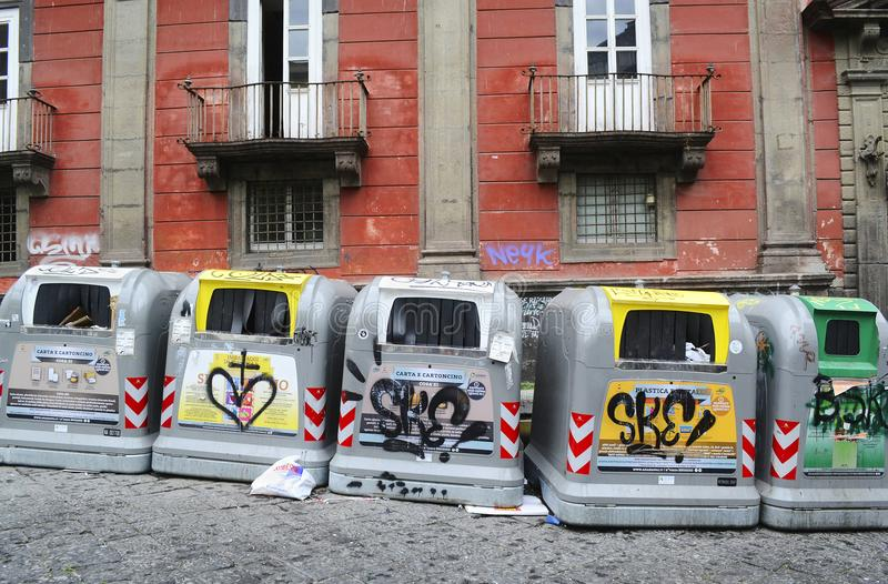 Selective waste collection bins on the street in Naples royalty free stock images
