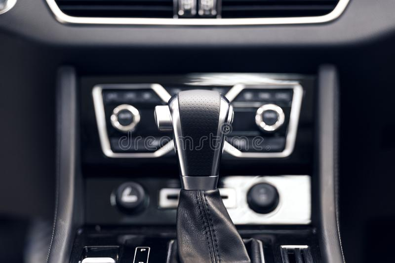 Selector automatic transmission with perforated leather in the interior of a modern expensive car royalty free stock photos