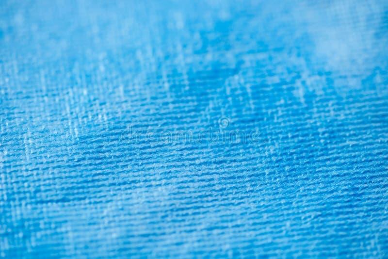 Selektiv fokus för blå aristic textur för kanfasmakrobakgrund arkivbilder