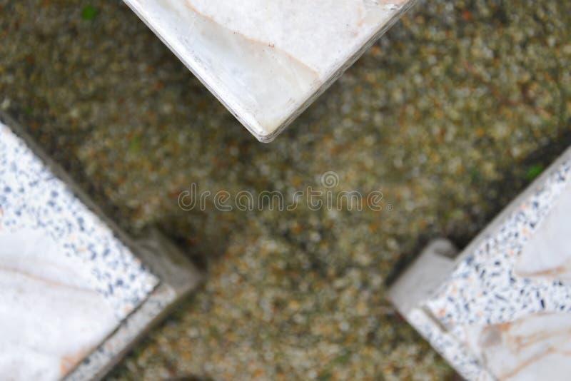 Selektive Fokussierung des abstrakten Dreieckgranittischs bei Conor passend für Hintergrundhintergrund lizenzfreies stockbild