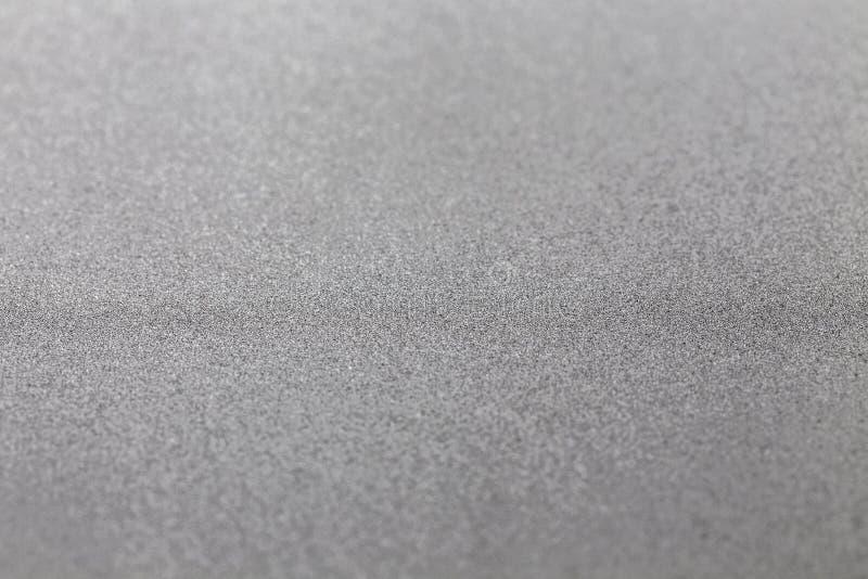 Selektiver Fokus des grauen silbernen metallischen Hintergrundes des Funkelns glänzenden modernen kalten industriellen strukturie stockbild