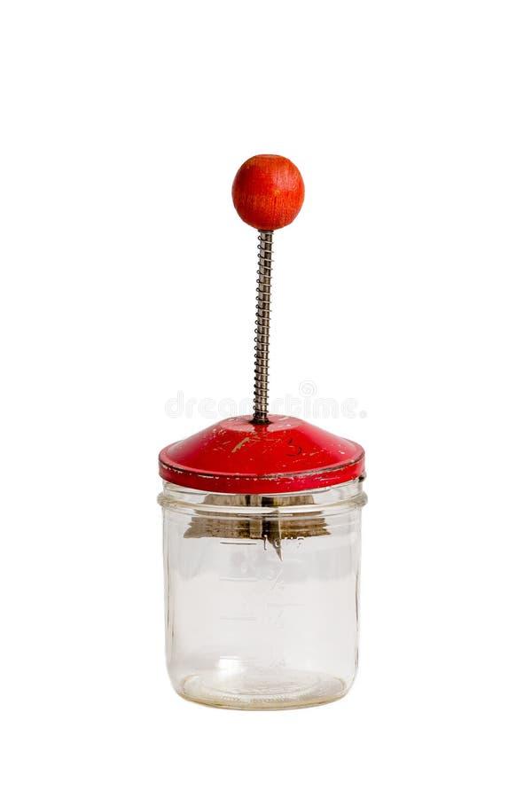 Selettore rotante antico rosso del dado sul barattolo di misurazione di vetro immagini stock libere da diritti
