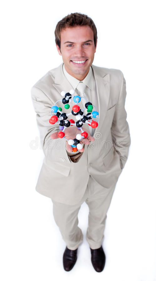 Download Self-assured Businessman Holding A Molecule Royalty Free Stock Photography - Image: 12445977