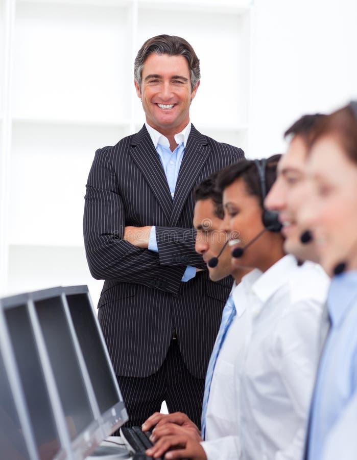 Self-assured businessman presenting a call center royalty free stock photos