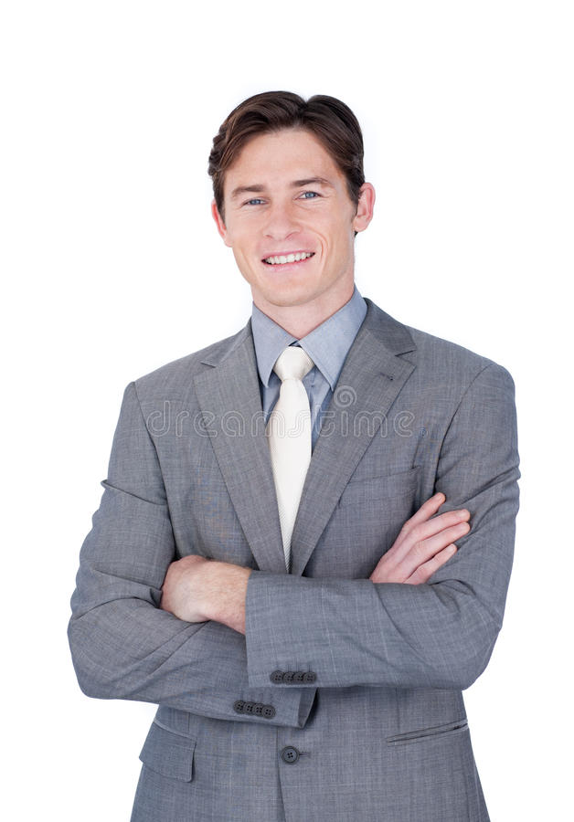 Self-assured businessman standing with folded arms. In front of the camera royalty free stock photography