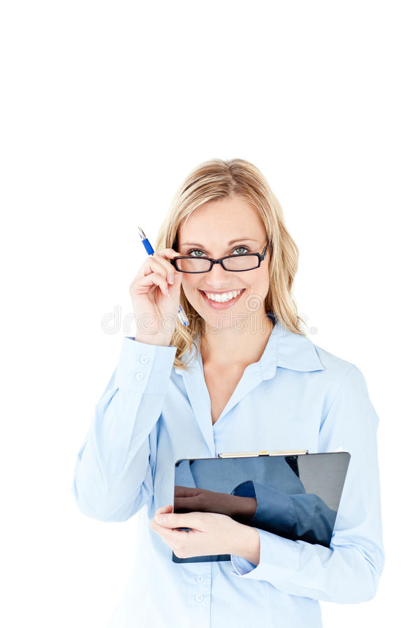 Self-assured businesswoman holding a clipboard royalty free stock photos