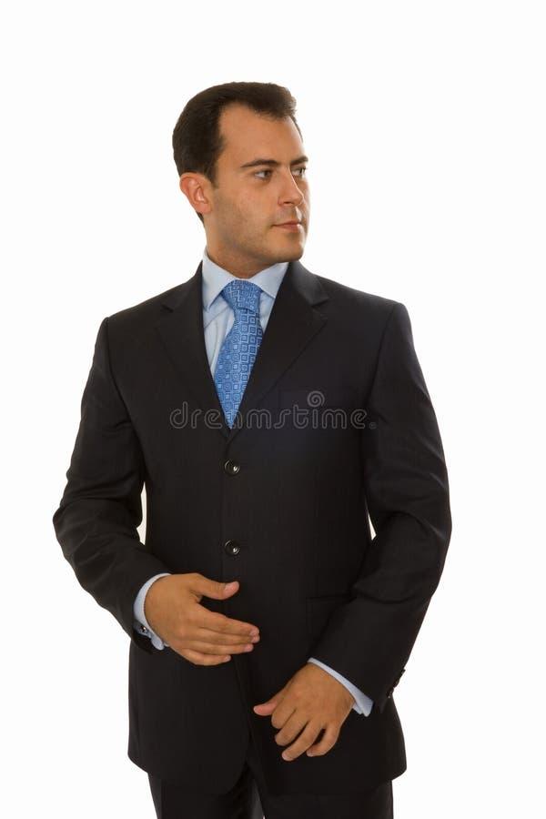 Self-assured junger Geschäftsmann, der nach links schaut lizenzfreie stockbilder