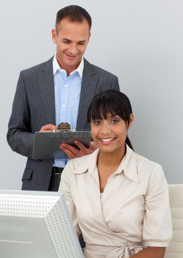 Download Self-assured Manager Checking His Employee's Work Stock Photo - Image: 12401750