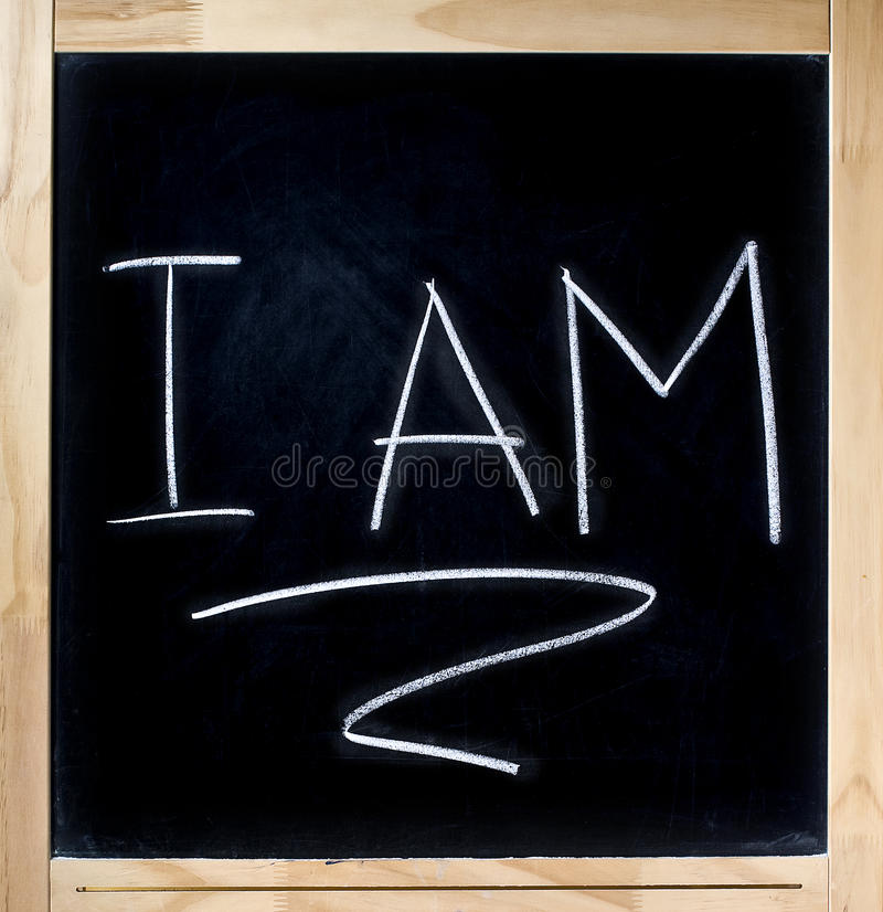 Self Awareness. I AM underlined handwritten with white chalk on blackboard to develop self awareness. Object isolated on white background stock image