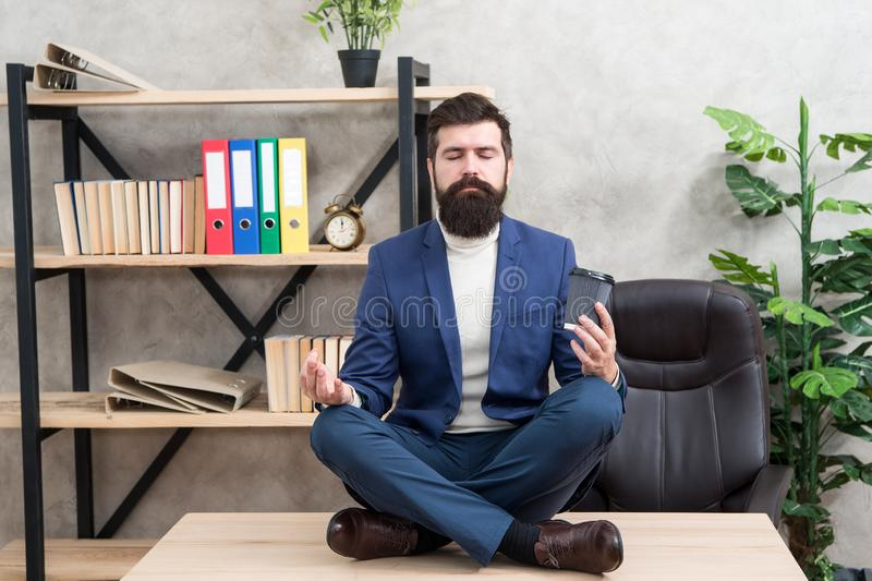 Self care. Psychological help. Relaxation techniques. Mental wellbeing and relax. Man bearded manager formal suit sit stock photography