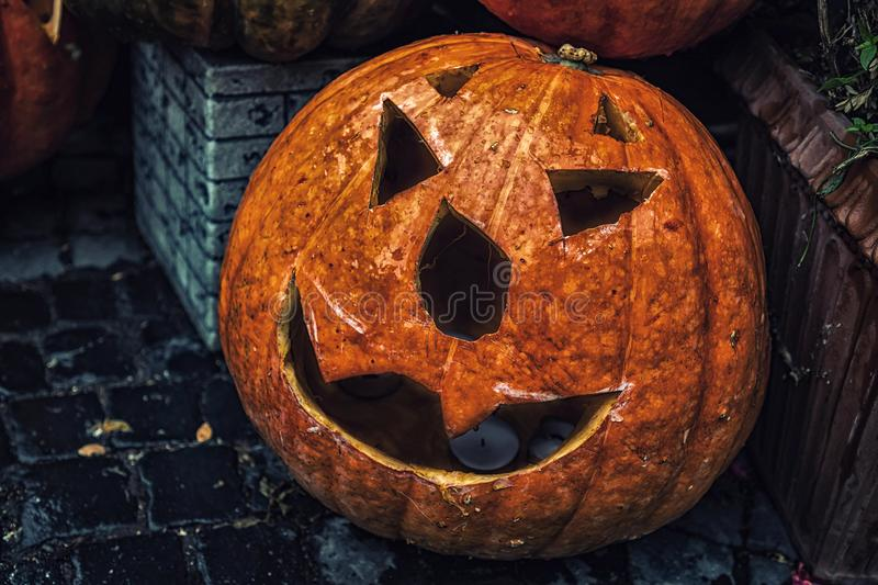 Self-carved pumpkins on the street as decoration for Halloween i royalty free stock photography